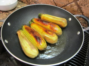 Meantime heat 1/2 cup of oil in a large nonstick skillet and fry the eggplants until golden brown.