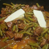 Add green beans, saffron and 2 tablespoons butter. Cook for 30 minutes or until beans are cooked. Taste and adjust seasoning.