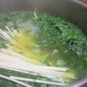 Break reshteh in half and add to the pot. Stir to avoid resheth from sticking together. Cook for 5 minutes.