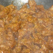 Fry for 5 minutes or until tomato paste changes the color of oil.