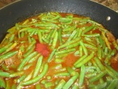 When meat is almost cooked, add cut green beans and saffron.
