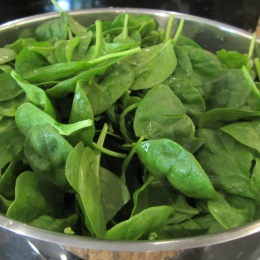 In a large deep skillet cook spinach over high heat for 5 minutes or until welted.