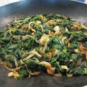 Spread out the spinach mixture evenly on the bottom of the skillet.
