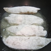 Heat oil in a large nonstick frying pan. Dredge the fish fillets in flour, shaking off excess flour then add to the pan. Fry for about 10 minutes or until golden brown.