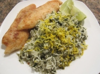 Squeeze fresh lemon juice on mahi, serve with sabzi polo.