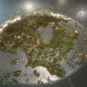 Heat 2 tablespoons of oil in the same pan over medium heat. Add 1 teaspoon dried mint. Fry for about 2 to 3 minutes or until the color of oil changes to green. Transfer to a bowl and set aside.
