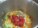Add thyme, bay leaf, salt, pepper and tomatoes.
