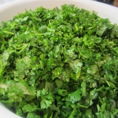 Clean parsley and cilantro by cutting off the stems. Cut off the root ends of green onions. Wash, rinse and coarsely chop all the herbs.