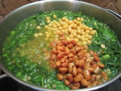 Add cooked beans and stir.