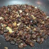 Heat 2 tablespoons oil in a small nonstick skillet over medium high heat. Add 2 tablespoons chopped onions. Fry for 4 to 5 minutes or until fragrant and slightly golden. Stir in raisins. Take off heat and set aside.