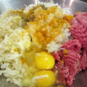 Add ground beef, rice, potatoes, onion, salt, turmeric, pepper and eggs to a large bowl.
