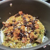 Add 4 tablespoons oil to the same pot used to cook the rice. Layer rice, lentils, raisins and meat. Continue to alternate the layers until all the ingredients are used.