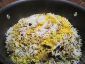 Pour saffron mixture over the rice.
