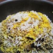 Pour saffron mixture over the rice.
