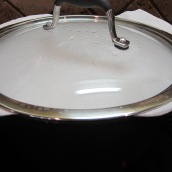 Place a clean dishtowel or 2 layers of paper towel over the pot and cover firmly with a lid to absorb the steam.