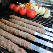 Place the skewers over the grill. To prevent the meat from falling off the skewers, keep turning the skewers over for the first few minutes of cooking to let the meat cook evenly on both sides.