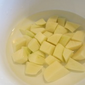 Place potatoes in a bowl of water to keep from turning brown.