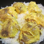 Cover with a layer of rice. Arrange chicken pieces over the rice, top with the remaining rice.