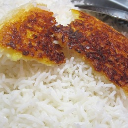 Polo and chelo are terms used interchangeably to describe rice that is parboiled then steamed. Plain rice served with stew or kabab is called chelo (chelo kabab) and rice mixed with other ingredients is called polo (sabzi polo).