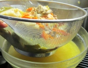 Strain the stock through a fine mesh strainer into a large bowl.