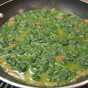When meat is almost cooked, stir in spinach, Persian aloo and 4 tablespoons fresh lemon juice.