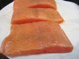Pat dry salmons with a paper towel. Generously season both sides with salt and pepper.