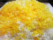 To plate the rice, gently scoop it out onto a serving platter, top with saffron rice.