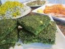 Serve kuku sabzi (herbs frittata) as a side dish with sabzi polo (herb rice).