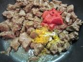 Stir in tomato paste, salt, pepper, turmeric and advieh.
