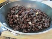 Heat 1 tablespoon butter and raisins in a small frying pan over medium heat for about 1 minute or until the butter melts. Remove from heat and set aside.