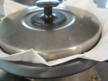 Cover and cook until the cycle finishes. Optional: place a clean dishtowel or 2 layers of paper towel over the pot and cover firmly with the lid to absorb the steam.
