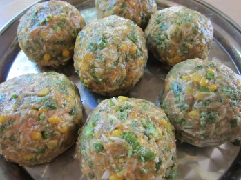 Divide the mixture into 8 portions. Using wet hands firmly shape each portion into a ball. Place meatballs on a large platter.
