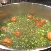 Add the fresh chopped herbs and limes to the pot, discard the whole onion. Cook for 1 hour or until the meat is fork tender.
