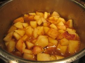 Add chopped quinces to the pot. Cover and simmer over low heat for about 20 minutes or until the quinces are cooked through.