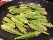 Heat 1 tablespoon of oil in a large skillet over medium-high heat. Add okras, cook for 3 to 4 minutes, stirring frequently.