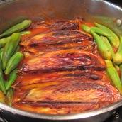 Add eggplants and okras to the sauce.