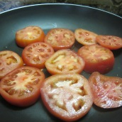 Heat a medium-sized skillet over medium- high heat. Arrange a layer of tomatoes in the skillet, sprinkle with salt. Cook for 5 minutes.