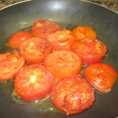 Turn the slices over. Add oil and cook for an additional 5 minutes or until tomatoes are slightly fried.