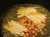 Break noodles in half and add to the pot along with the beans. Stir for few minutes to separate the noodle strands.