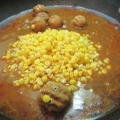 When meat is fork tender, stir in split peas and limes.