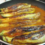 Gently arrange the eggplants on top. Cook for 30 minutes or until eggplants are tender.