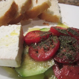 Top bread with feta cheese, tomato and cucumber. Drizzle with dressing.