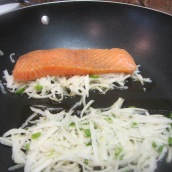 Heat olive oil in a nonstick skillet. Place two small, evenly spaced mounds of the potato mixture in the skillet. Press a piece of salmon onto each mound.