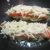 Cover salmons with more potato mixture.
