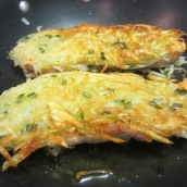 Fry the salmons, uncovered, over medium heat for 6 to 7 minutes or until the potatoes are golden brown and crispy. Carefully flip the salmons over and fry for an additional 6 to 7 minutes.
