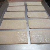 Cut the pastry puffs into 2 sections. Arrange on the oven tray, brush with butter.