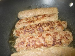 Shape meat mixture into oval patties. Cook on one side.
