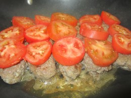Flip over. Top with sliced tomatoes. Cook until juices are gone.