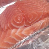 Cut the salmon crosswise, halfway from top to bottom, to end up with two pieces of salmon fillets.