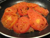 Cook until tomato juice is absorbed by the meat.